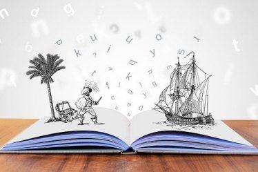 livres ouvert avec un bateau et des lettres qui s'envolent